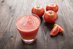 Healthy vegetable smoothie made of red ripe tomatoes on wooden t Royalty Free Stock Images