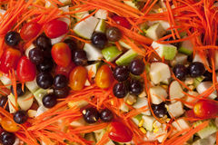Healthy vegetable and tropical fruits salad Stock Image