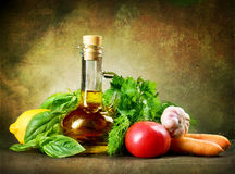 Healthy Vegetables and olive Oil. Olive Oil and  Fresh Vegetables.Old Styled Stock Image