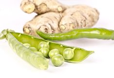 Healthy vegetables pea pod open, ginger and chilly royalty free stock images
