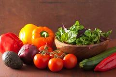 Healthy vegetables pepper tomato salad onion avocado on rustic b Royalty Free Stock Photos