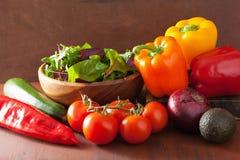 Healthy vegetables pepper tomato salad onion avocado on rustic b Stock Photo