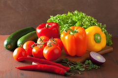 Healthy vegetables pepper tomato salad onion chilli on rustic ba Stock Photos