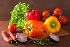Healthy vegetables pepper tomato salad onion on rustic backgroun Royalty Free Stock Photos