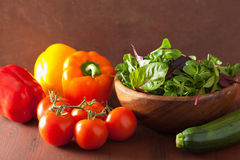 Healthy vegetables pepper tomato salad zucchini on rustic backgr Stock Image