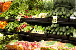 Healthy vegetables on store shelves Stock Photos