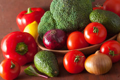 Healthy vegetables tomato avocado onion broccoli cucumber Stock Images