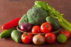 Healthy vegetables tomato avocado onion broccoli cucumber celery Royalty Free Stock Image