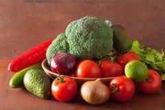Healthy vegetables tomato avocado onion broccoli cucumber celery Royalty Free Stock Photo