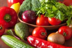 Healthy vegetables tomato avocado onion broccoli cucumber celery Stock Photo