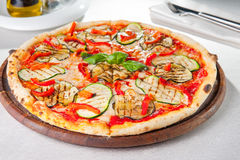 Healthy vegetables vegetarian pizza. With grilled zucchini and eggplant slices on the served table. Selective focus Royalty Free Stock Photo