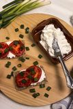 Healthy and vegetarian breakfast with crispbread, quark, tomatoes and spring onions royalty free stock images