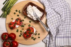 Healthy and vegetarian breakfast with crispbread, quark, tomatoes and spring onions stock photo