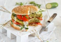 Healthy vegetarian burger. With broccoli burger, arugula, zucchini and tomatoes stock image