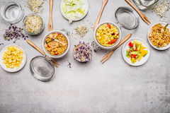 Healthy vegetarian corn salads. Various Salad in glass jars on gray stone background. royalty free stock photo