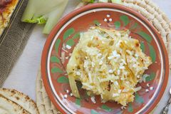 Healthy vegetarian dinner: oven baked fennel bulbs with potatoes. Royalty Free Stock Image