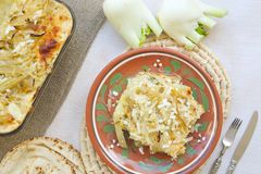 Healthy vegetarian dinner: oven baked fennel bulbs with potatoes. Royalty Free Stock Photography