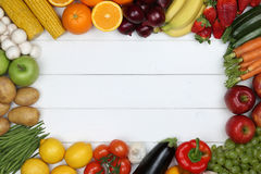 Healthy vegetarian eating frame from vegetables and fruits with. Healthy vegetarian and vegan eating frame from vegetables and fruits with copyspace stock photography