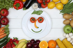 Healthy vegetarian eating smiling face from vegetables and fruit Royalty Free Stock Photography