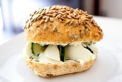 Healthy vegetarian egg and cucumber bread roll with sunflower se Royalty Free Stock Photos