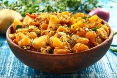 Healthy Vegetarian food aloo jeera. Indian cuisine-Healthy Vegetarian food aloo jeera on a wooden table Royalty Free Stock Images