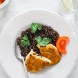 Healthy Vegetarian Food. Black quinoa, oatmeal cutlets and lemon. Top View Healthy Vegetarian Food. Plate with black quinoa and oatmeal cutlets with prunes on stock images