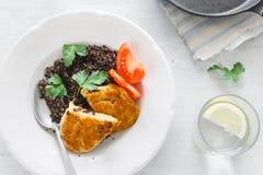 Healthy Vegetarian Food. Black quinoa, oatmeal cutlets and lemon. Top View Healthy Vegetarian Food. Plate with black quinoa and oatmeal cutlets with prunes on royalty free stock photos