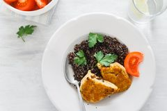 Healthy Vegetarian Food. Black quinoa, oatmeal cutlets, lemon wa. Top View Healthy Vegetarian Food. Plate with black quinoa and oatmeal cutlets with prunes on royalty free stock photography