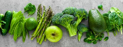 Healthy vegetarian food concept background, fresh green food selection for detox diet, raw broccoli, apple, cucumber, spinach. Peas, asparagus, avocado, lime stock photo