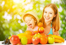 Healthy vegetarian food. happy family mother and baby daughter w Stock Photography