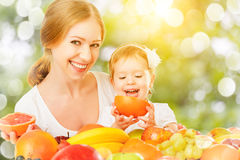 Healthy vegetarian food. happy family mother and baby daughter w Royalty Free Stock Images