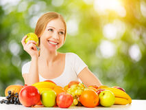 Healthy vegetarian food. happy woman eating apple in summer Stock Images