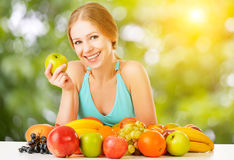 Healthy vegetarian food. happy woman eating apple in summer Stock Photos