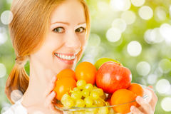Healthy vegetarian food. happy woman with a plate of fruit in summer. Healthy vegetarian food. happy woman with a plate of fruit in the summer royalty free stock photos