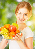 Healthy vegetarian food. happy woman with a plate of fruit in su Royalty Free Stock Photography