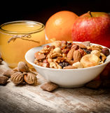 Healthy vegetarian food - organic nuts, orange juice and fruits Royalty Free Stock Photos