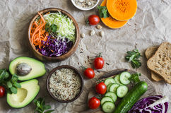 Free Healthy Vegetarian Food Set Background With Free Space For Text. Cabbage, Avocado, Tomatoes, Cucumbers, Pumpkin, Wild Rice On A Pa Royalty Free Stock Images - 92665619