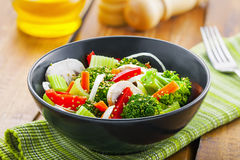 Healthy vegetarian food. Healthy vegetable salad made of steamed broccoli, onion, mushroom, carrot and pepper. Vegetarian food Stock Photography