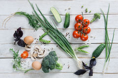 Healthy vegetarian food on white rustic wooden background royalty free stock photo
