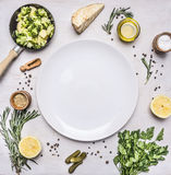 Healthy vegetarian foods, broccoli sprouts in a small frying pan, oil and seasonings, herbs lemon place text,frame on wood Stock Photos