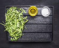 Healthy vegetarian foods green salad of cucumber, spinach and arugula with oil and salt  wooden tray place for text on wooden Stock Photo
