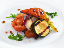 Healthy vegetarian grilled vegetables. Served on a white round plate royalty free stock photography