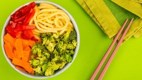 Healthy Vegetarian Hawaiian Style Food Bowl. Healthy Vegetarian Hawaiian Style Buddha Food Bowl With Broccoi Carrots Red Peppers and Egg Noodles Against A Green royalty free stock images