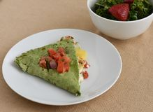 Healthy Vegetarian lunch dish with squash, cheese, tomatoes, and spinach wrap Stock Image