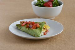 Healthy Vegetarian lunch dish with squash, cheese, tomatoes, and spinach wrap Royalty Free Stock Photo