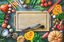 Healthy or vegetarian nutrition concept with selection of organic autumn fruits and vegetables. On rustic wooden table stock images