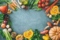 Healthy or vegetarian nutrition concept with selection of organic autumn fruits and vegetables. On rustic wooden table stock photos