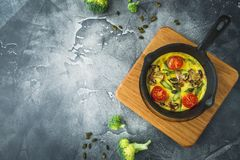 Healthy vegetarian omelet in frying pan and pumpkin seed. Flat lay, copy space Royalty Free Stock Photography