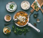 Healthy vegetarian one pot couscous with vegetables and feta cheese in white pan, top view. Royalty Free Stock Photos