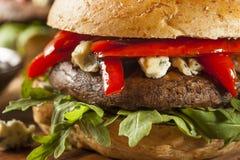 Healthy Vegetarian Portobello Mushroom Burger. With Cheese and Veggies royalty free stock photo